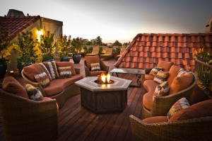 Staggering-Rooftop-Furniture-Ideas-in-Deck-Traditional-design-ideas-with-brown-outdoor-cushions-fire-pit-glass-coffee