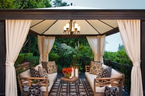 Wooden-Bench-with-Cushions-and-Square-Pattern-Rug-Shaded-by-Wooden-Gazebo-with-Curtain-in-Traditional-Patio-Design-Ideas