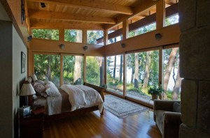 Lovely-lake-view-bedroom-with-an-elegant-sleigh-bed-